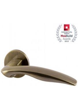 Ручка дверная ARMADILLO - Wave URS AB-7 (бронза)